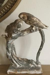 2 parakeet statue
